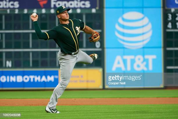 Matt Chapman of the Oakland Athletics fields the ball against the Houston Astros during the first inning of a baseball game at Minute Maid Park on...
