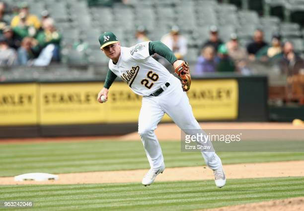 Matt Chapman of the Oakland Athletics fields the ball at third base against the Chicago White Sox at Oakland Alameda Coliseum on April 18 2018 in...