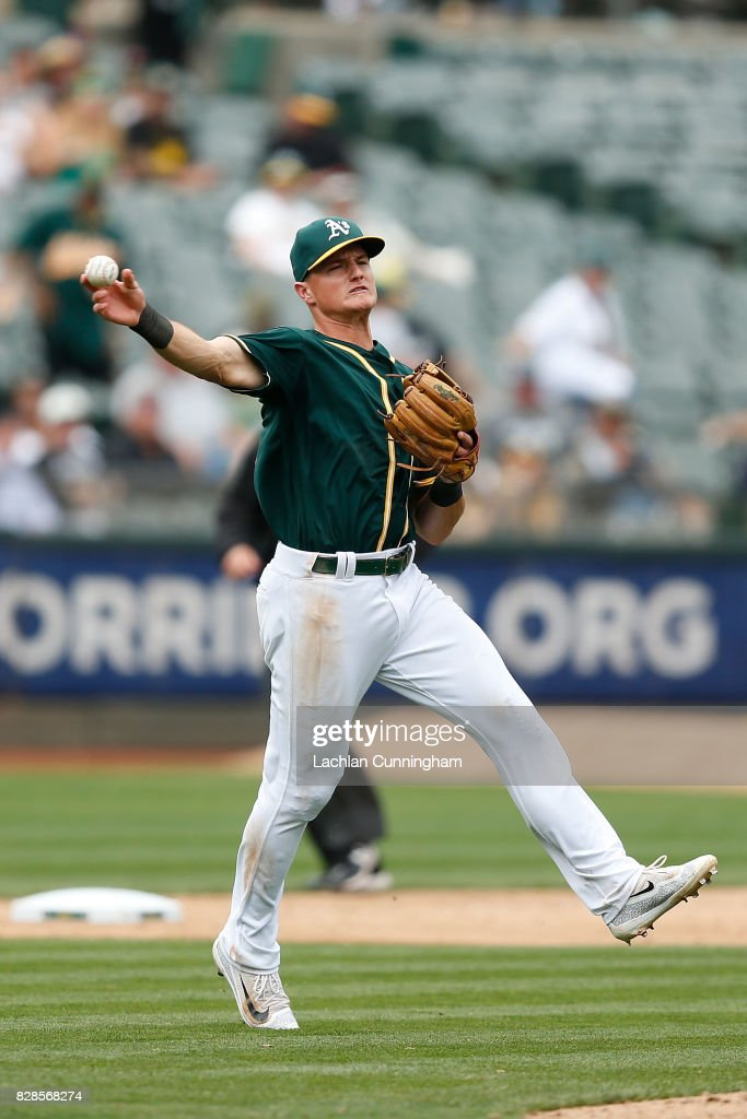 Matt Chapman #26 of the Oakland Athletics finds the ball at third base and throws to first to get the out of Carlos Ruiz #52 of the Seattle Mariners in the ninth inning at Oakland Alameda Coliseum on August 9, 2017 in Oakland, California.