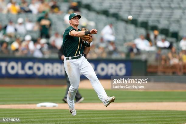 Matt Chapman of the Oakland Athletics finds the ball at third base and throws to first to get the out of Carlos Ruiz of the Seattle Mariners in the...