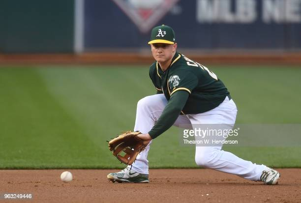 Matt Chapman of the Oakland Athletics goes down to field a ground ball off the bat of Guillermo Heredia of the Seattle Mariners in the top of the...