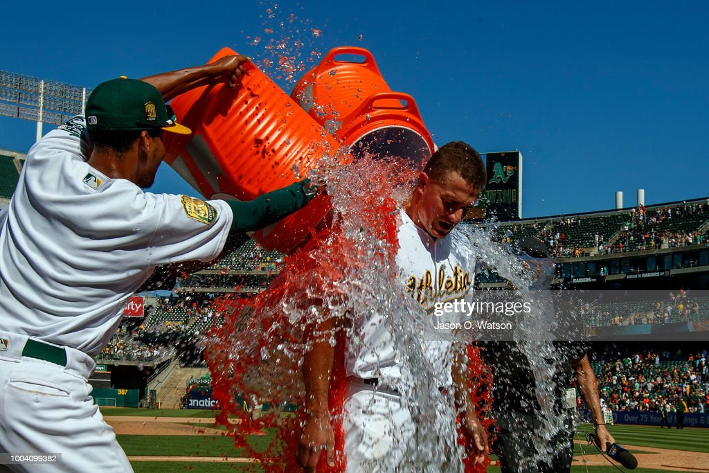 Matt Chapman #26 of the Oakland Athletics has Gatorade poured on him after hitting a walk off RBI single after the game against the San Francisco Giants at the Oakland Coliseum on July 22, 2018 in Oakland, California. The Oakland Athletics defeated the San Francisco Giants 6-5 in 10 innings.