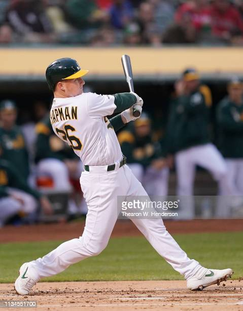 Matt Chapman of the Oakland Athletics hits a solo home run against the Boston Red Sox in the bottom or the first inning at OaklandAlameda County...