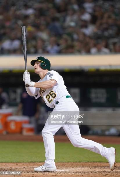 Matt Chapman of the Oakland Athletics hits a solo home run against the Houston Astros in the bottom of the eighth inning at Ring Central Coliseum on...