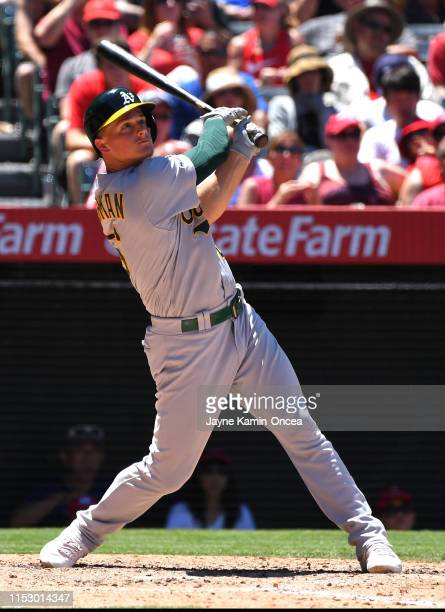 Matt Chapman of the Oakland Athletics hits a two run home run in the fifth inning of the game against the Los Angeles Angels at Angel Stadium of...