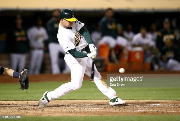 Matt Chapman of the Oakland Athletics hits a walkoff home run to beat the Tampa Bay Rays at Ring Central Coliseum on June 20 2019 in Oakland...