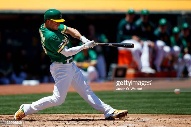 Matt Chapman of the Oakland Athletics hits an RBI ground out during the third inning against the Chicago White Sox at the RingCentral Coliseum on...