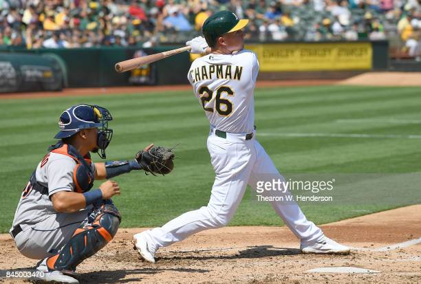 Matt Chapman of the Oakland Athletics hits an RBI triple scoring Matt Olson against the Houston Astros in the bottom of the second inning during game...