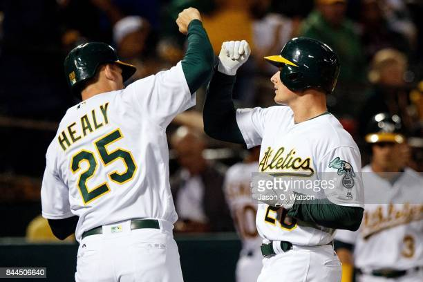 Matt Chapman of the Oakland Athletics is congratulated by Ryon Healy after hitting a two-run home run against the Houston Astros during the second...