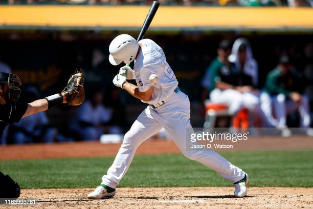 Matt Chapman of the Oakland Athletics is hit by a pitch from Logan Webb of the San Francisco Giants during the fifth inning at the RingCentral...