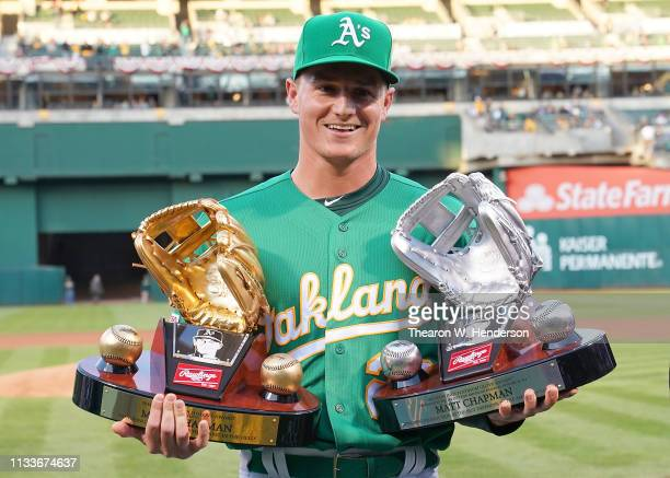 Matt Chapman of the Oakland Athletics is presented with his Rawlings 2018 Gold and Platinum Glove awards prior to the start of his game against the...