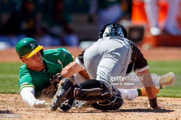 Matt Chapman of the Oakland Athletics is tagged out at home plate by James McCann of the Chicago White Sox during the eighth inning at the...