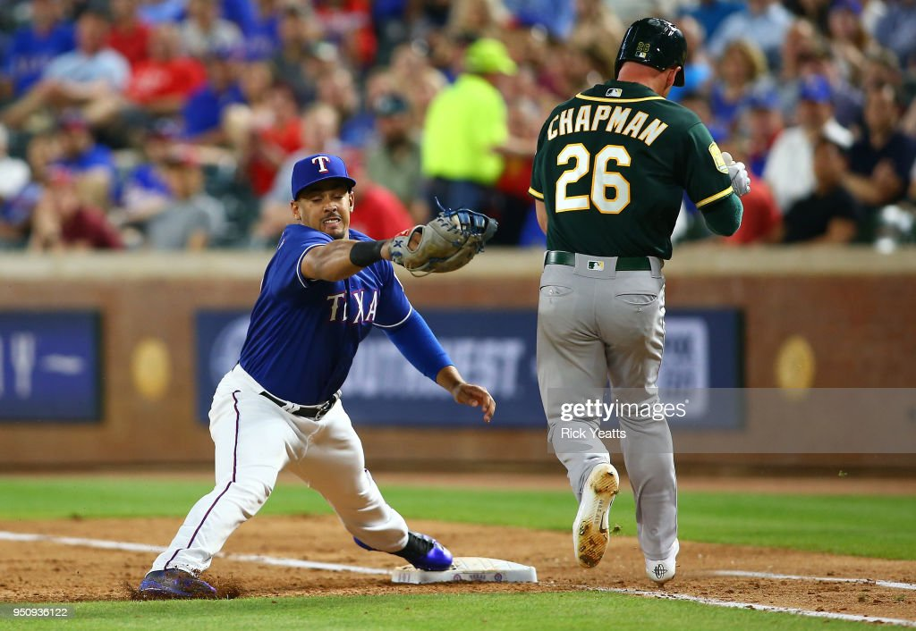 Matt Chapman #26 of the Oakland Athletics is thrown out first base in the sixth inning against Ronald Guzman #67 of the Texas Rangers at Globe Life Park in Arlington on April 24, 2018 in Arlington, Texas.