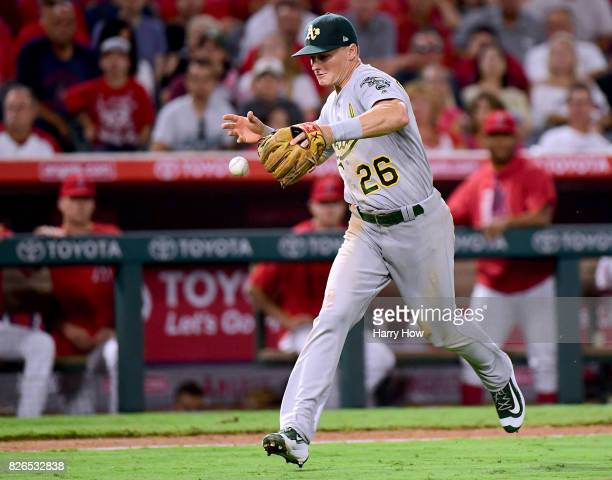 Matt Chapman of the Oakland Athletics juggles an infield single from Yunel Escobar of the Los Angeles Angels scoring Ben Revere for a 76 Angel lead...