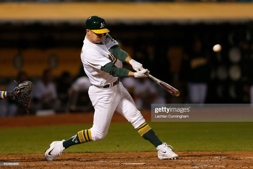 Matt Chapman #26 of the Oakland Athletics lines into a force out in the fourth inning against the Texas Rangers at Oakland Alameda Coliseum on September 23, 2017 in Oakland, California.