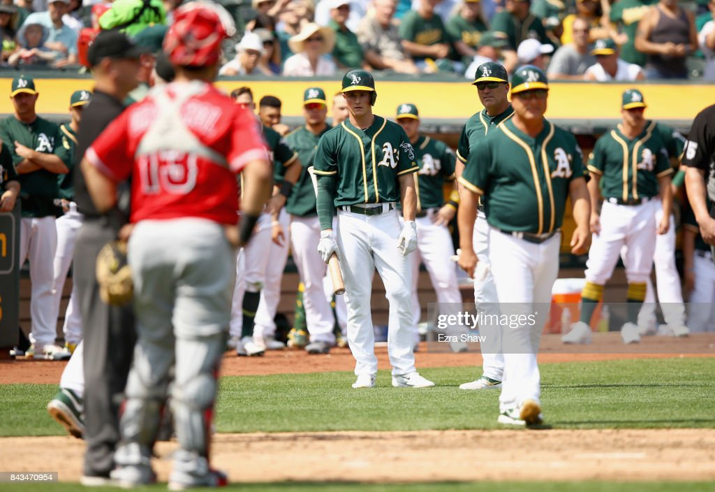 Matt Chapman #26 of the Oakland Athletics looks back at Juan Graterol #13 of the Los Angeles Angels after he was ejected in the fourth inning at Oakland Alameda Coliseum on September 6, 2017 in Oakland, California. Chapman was ejected on the play.
