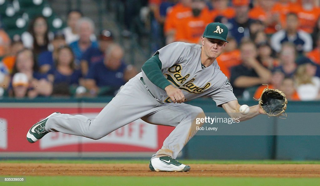 Matt Chapman #26 of the Oakland Athletics makes a play on a ground ball by Alex Bregman #2 of the Houston Astros in the eighth inning at Minute Maid Park on August 18, 2017 in Houston, Texas.