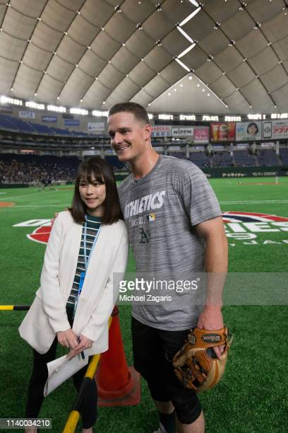 Matt Chapman of the Oakland Athletics poses with a fan prior to the game against the Hokkaido NipponHam Fighters at the Tokyo Dome on March 18 2019...