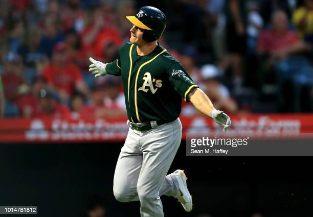 Matt Chapman of the Oakland Athletics reacts after hitting a solo homerun during the first inning of a game against the Los Angeles Angels of Anaheim...
