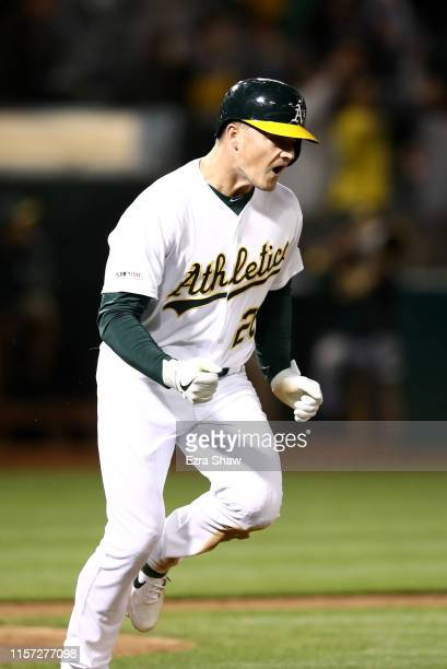 Matt Chapman of the Oakland Athletics reacts as he rounds the bases after he hit a walkoff home run to beat the Tampa Bay Rays at Ring Central...