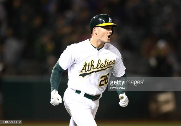 Matt Chapman of the Oakland Athletics reacts as he rounds the bases after he hit a walk-off home run to beat the Tampa Bay Rays at Ring Central...