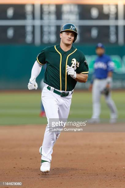 Matt Chapman of the Oakland Athletics rounds the bases after hitting a two-run home run in the bottom of the fifth inning against the Texas Rangers...
