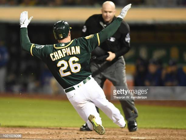 Matt Chapman of the Oakland Athletics scores against the Texas Rangers in the bottom of the fifth inning at Oakland Alameda Coliseum on August 21...