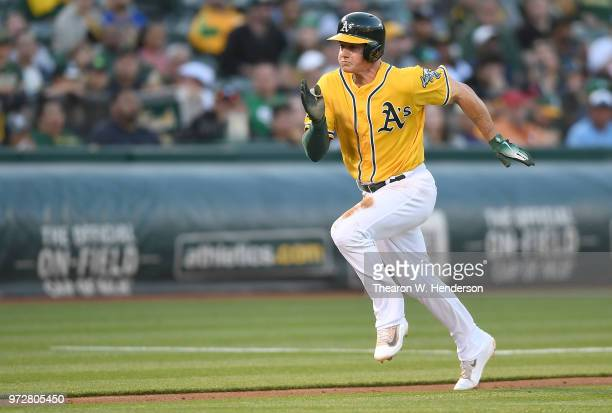 Matt Chapman of the Oakland Athletics scores on a sacrifice fly against the Houston Astros in the bottom of the second inning at the Oakland Alameda...