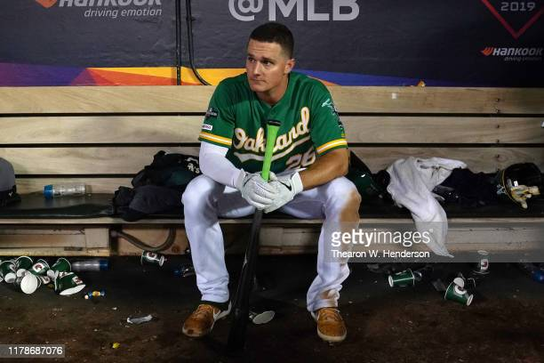 Matt Chapman of the Oakland Athletics sits in the dugout after being defeated 5-1 by the Tampa Bay Rays during the American League Wild Card Game at...