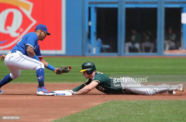 Matt Chapman of the Oakland Athletics slides safely into second base with a double in the second inning during MLB game action as Yangervis Solarte...