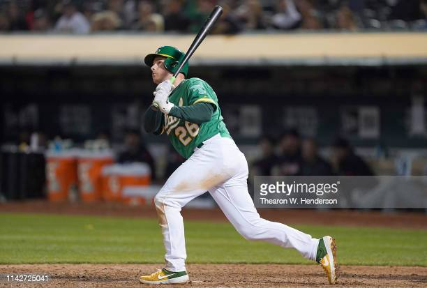 Matt Chapman of the Oakland Athletics swings and watches the flight of his ball as he hits a solo walkoff home run to defeat the Cleveland Indians 43...
