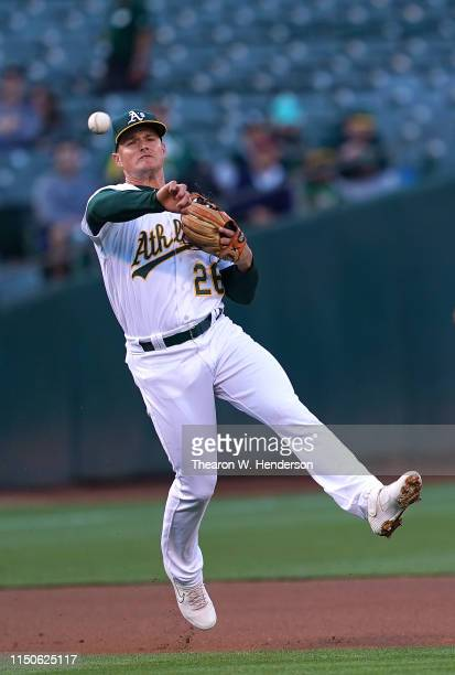Matt Chapman of the Oakland Athletics throws off balance to first base throwing out Pedro Severino of the Baltimore Orioles in the top of the first...