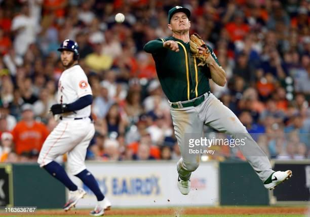Matt Chapman of the Oakland Athletics throws out Alex Bregman of the Houston Astros in the second inning at Minute Maid Park on July 22, 2019 in...