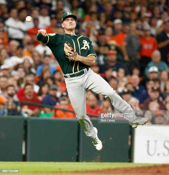Matt Chapman of the Oakland Athletics throws out Max Stassi of the Houston Astros in the second inning at Minute Maid Park on July 10 2018 in Houston...