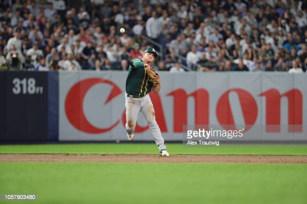 Matt Chapman of the Oakland Athletics throws the ball to first base during the American League Wild Card game against the New York Yankees at Yankee...