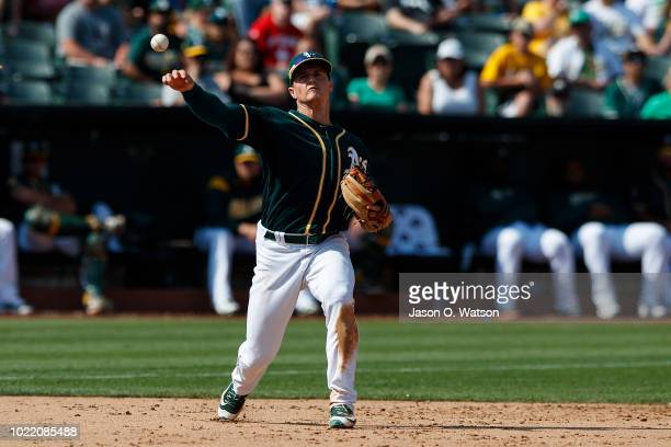 Matt Chapman of the Oakland Athletics throws to first base against the Houston Astros during the ninth inning at the Oakland Coliseum on August 19...