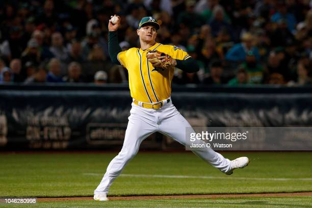 Matt Chapman of the Oakland Athletics throws to first base against the Minnesota Twins during the fifth inning at the Oakland Coliseum on September...