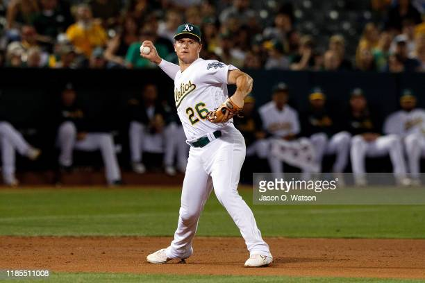 Matt Chapman of the Oakland Athletics throws to first base against the Texas Rangers during the sixth inning at the RingCentral Coliseum on September...