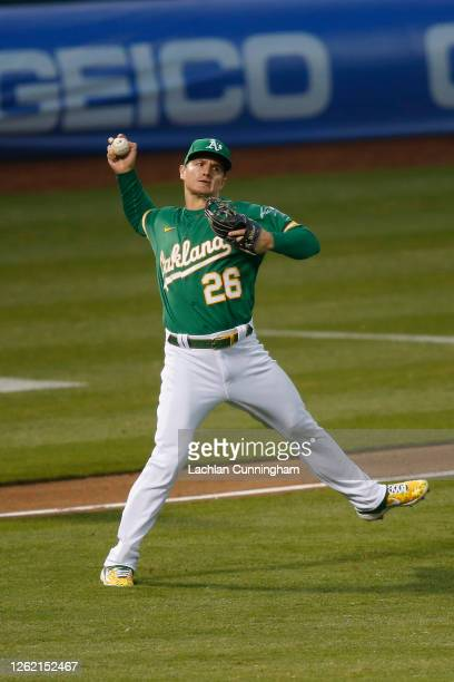 Matt Chapman of the Oakland Athletics throws to first base but is unable to get the out in the top of the fifth inning against the Colorado Rockies...