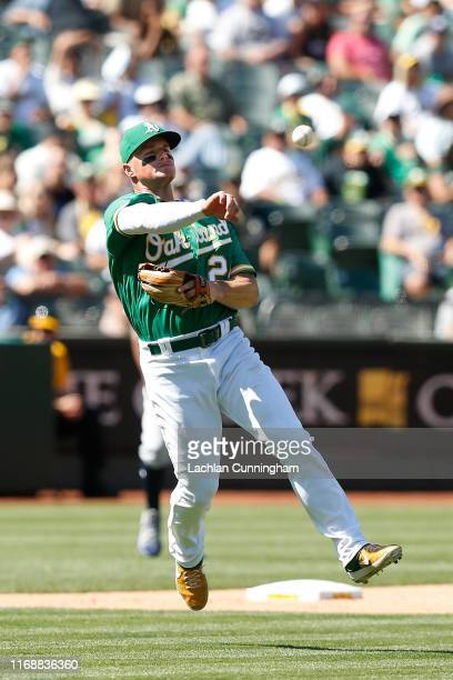 Matt Chapman of the Oakland Athletics throws to first base but not in time to get the out of Michael Brantley of the Houston Astros in the top of the...