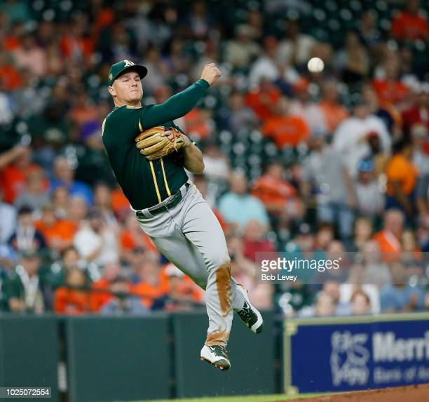 Matt Chapman of the Oakland Athletics throws to first base but unable to retire Alex Bregman of the Houston Astros in the first inning at Minute Maid...