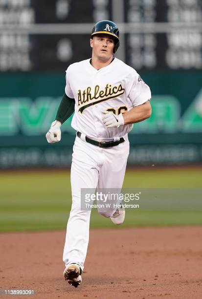 Matt Chapman of the Oakland Athletics trots around the bases after hitting a solo home run against the Texas Rangers in the bottom of the first...
