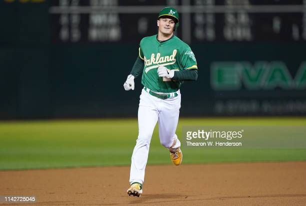 Matt Chapman of the Oakland Athletics trots around the bases smiling after hitting a solo walk-off home run to defeat the Cleveland Indians 4-3 in...