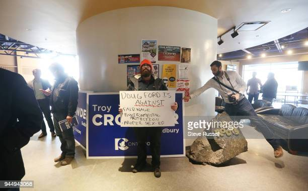 Matt Charon holds a sign with a couple key points he feels Dog Ford is against. Charon was allowed to stay for the rally. PC Leader Doug Ford skips...