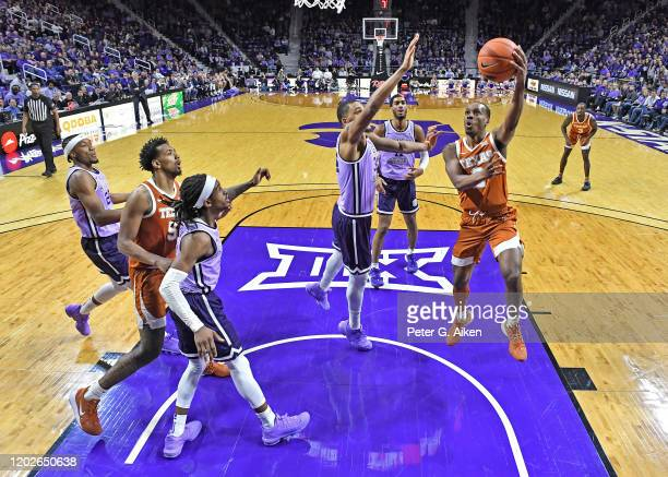 Matt Coleman III of the Texas Longhorns drives in for a basket against the Kansas State Wildcats during the second half at Bramlage Coliseum on...