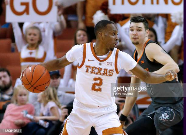 Matt Coleman III of the Texas Longhorns moves with the ball against Thomas Dziagwa of the Oklahoma State Cowboys at The Frank Erwin Center on...