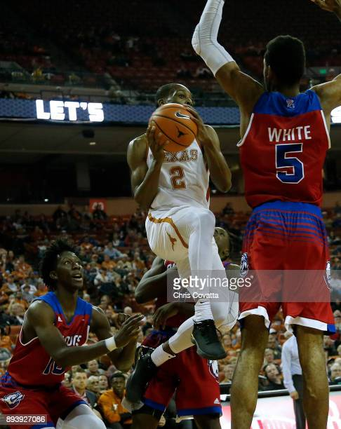 Matt Coleman of the Texas Longhorns leaps to the basket against Joniah White of the Louisiana Tech Bulldogs at the Frank Erwin Center on December 16...