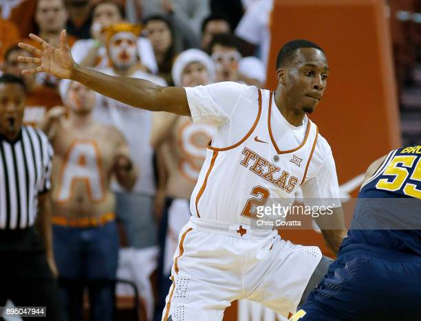 Matt Coleman of the Texas Longhorns plays defense against the Michigan Wolverines at the Frank Erwin Center on December 12 2017 in Austin Texas