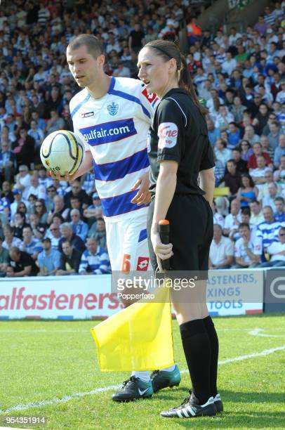 Matt Connolly of QPR and assistant referee Sian Massey during the npower Championship match between Watford and Queens Park Rangers at Vicarage Road...