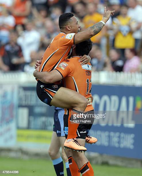 Matt Cook of Castleford Tigers celebrates with teammate Ben Roberts after he scores the fourth try for his side during the First Utility Super League...